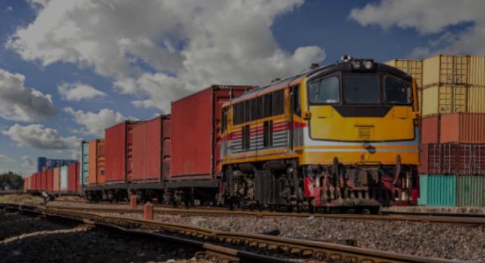 A train in a train yard illustrating the word rail.